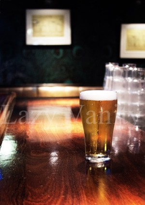 Edited Image of Beer Glass on Bar's Counter